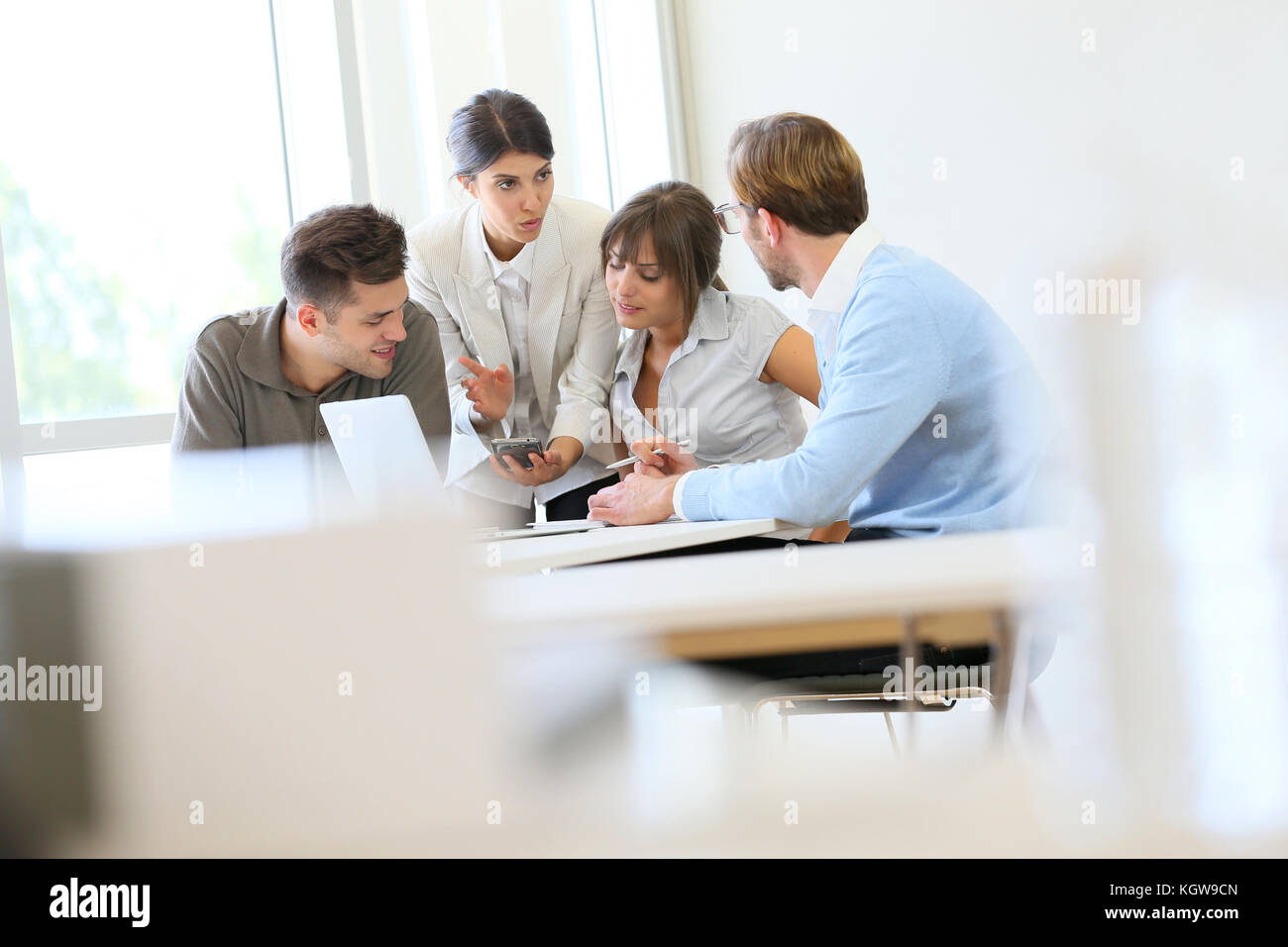 Business people meeting around table - Stock Image