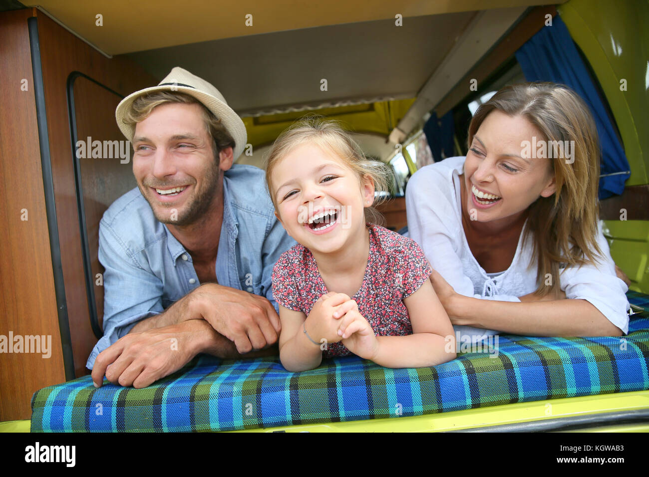 Portrait of cheerful family having fun in camper - Stock Image