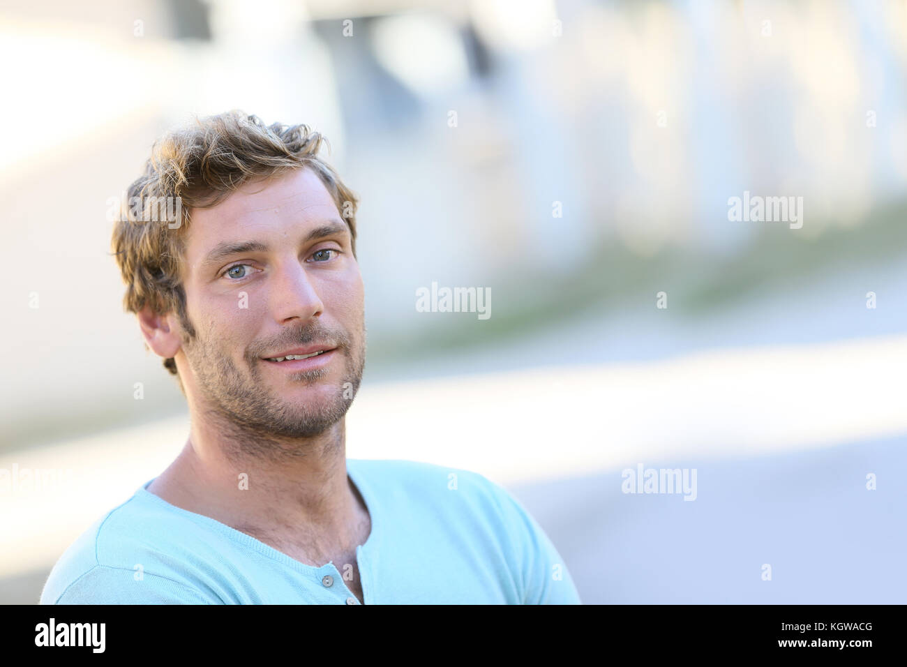 Portrait of handsome 30-year-old man - Stock Image