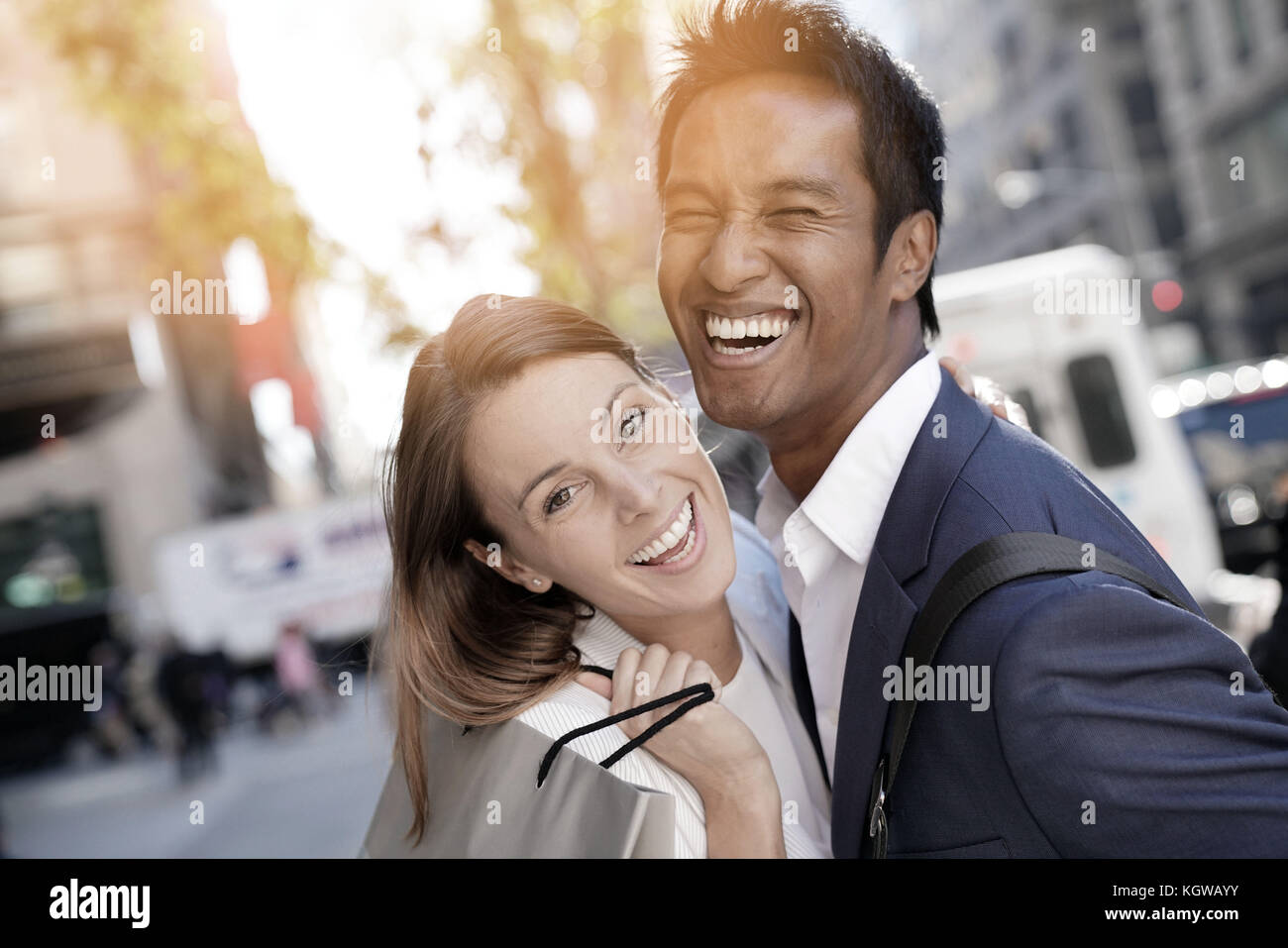 Cheerful couple doing shopping in New York city - Stock Image