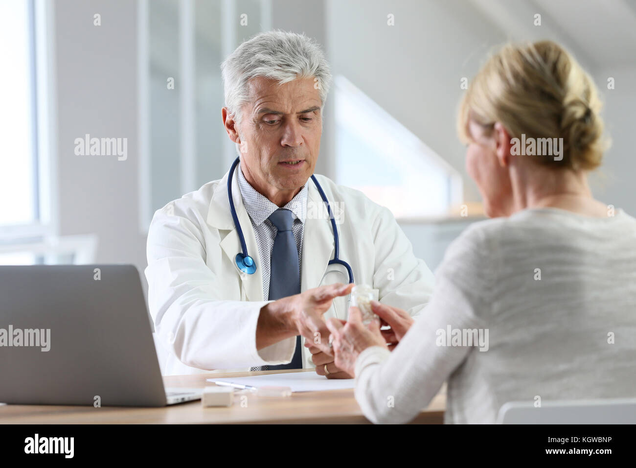 Doctor having consultation with patient in office - Stock Image