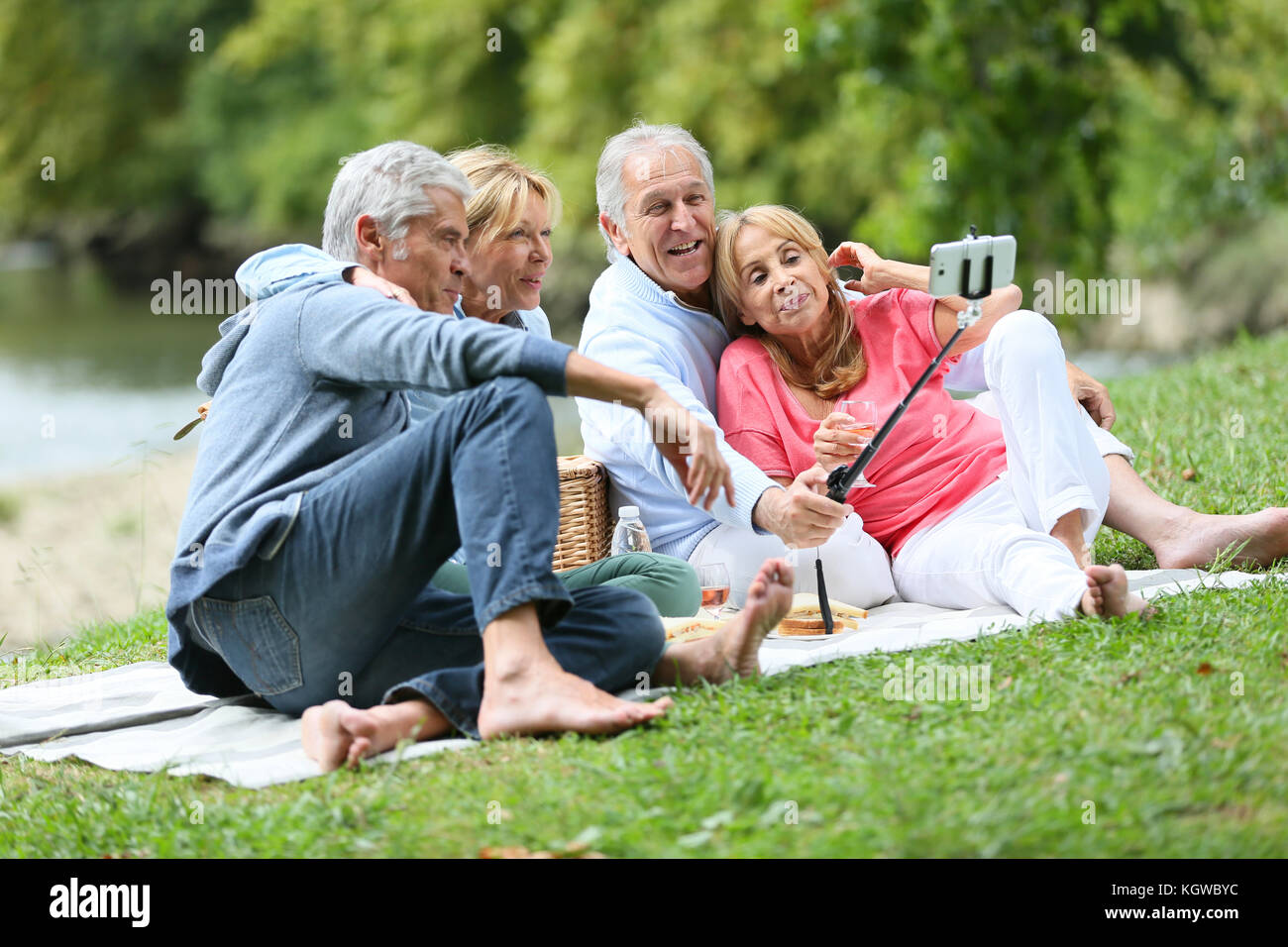 Group of senior people making selfy picture - Stock Image