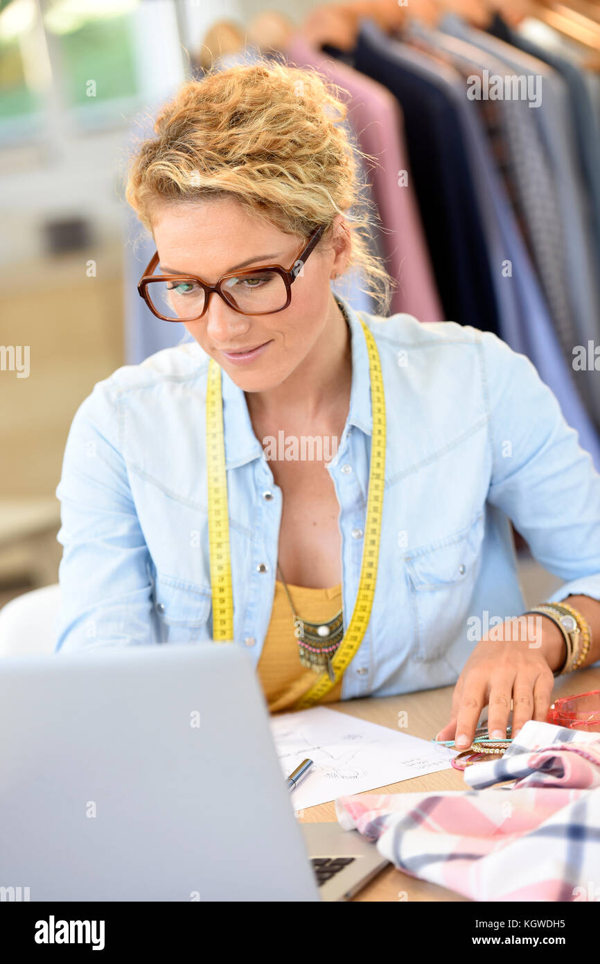 Beautiful woman fashion designer in office - Stock Image