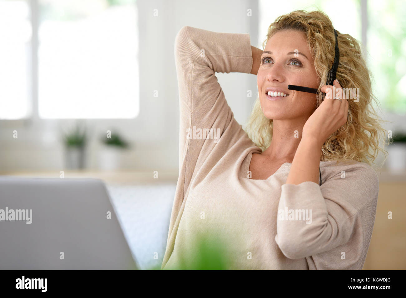 Woman working from home-office, telework - Stock Image