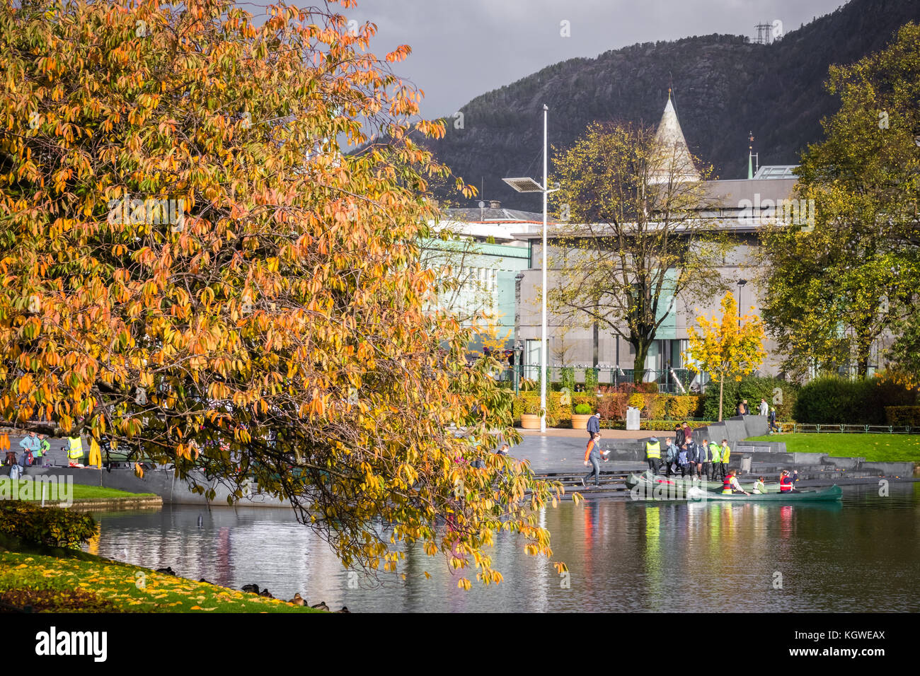 Bergen, Norway -  October 2017 : People about to embark on small boats on the Lille Lungegardsvannet small lake, - Stock Image