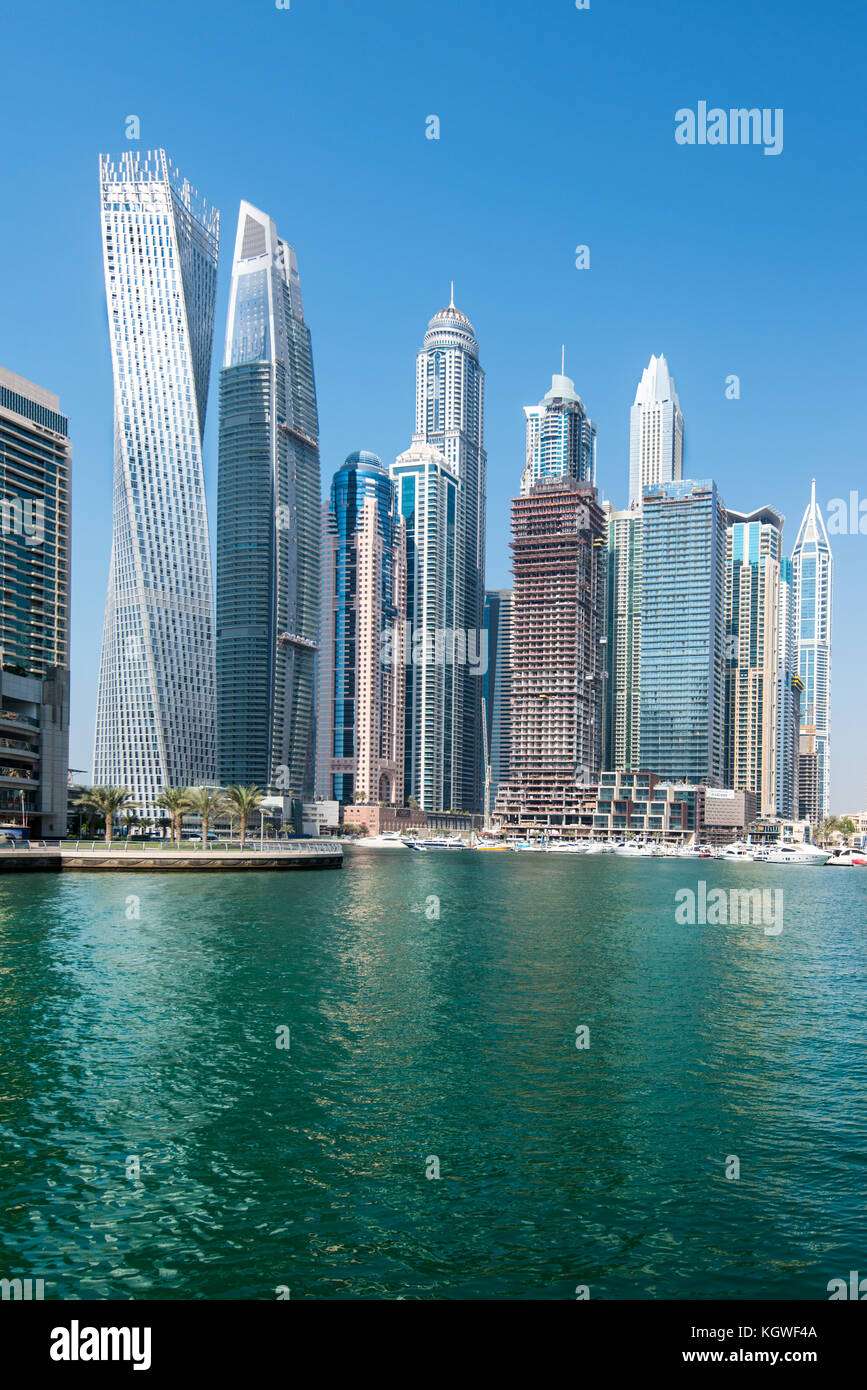 DUBAI, UAE - 31OCT2017: Iconic towers in Dubai Marina including (l-r) Cayan, Damac Heights, Marriott, Emirates Crown, - Stock Image