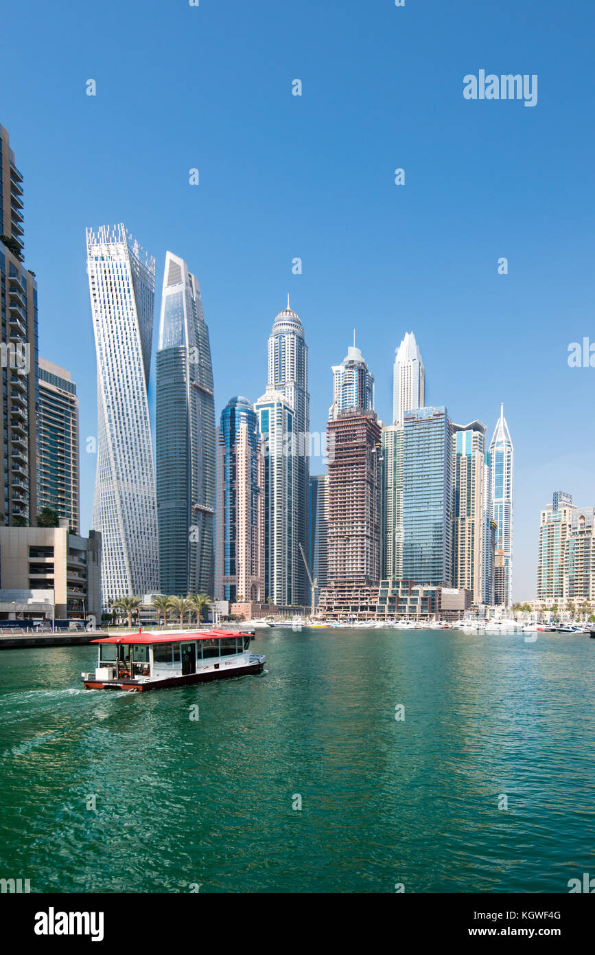 DUBAI, UAE - 31OCT2017: A Water Bus moving towards the Iconic towers of Dubai Marina including (l-r) Cayan, Damac - Stock Image