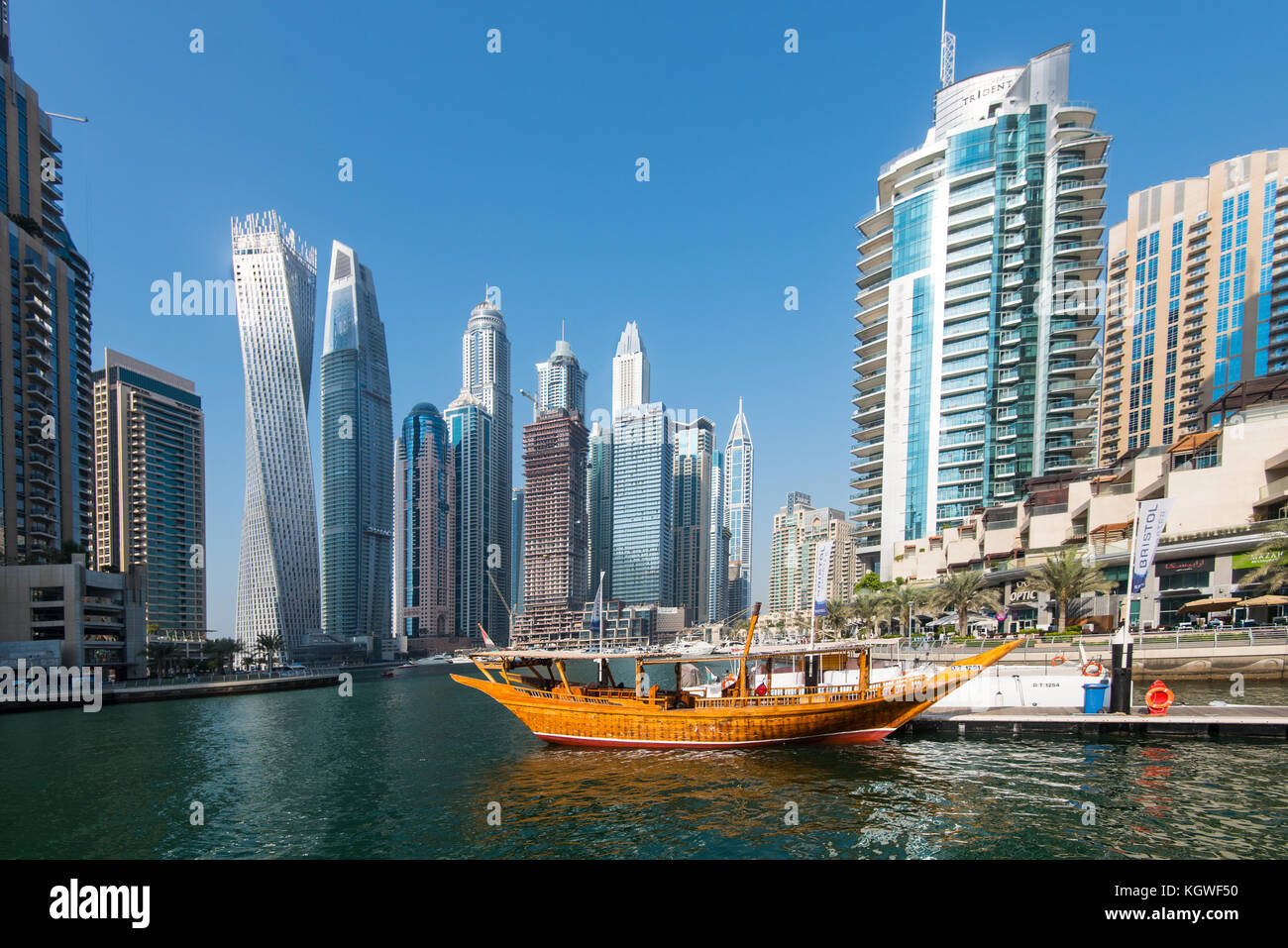 DUBAI, UAE - 31OCT2017: A dhow backed by the Iconic towers of Dubai Marina including (l-r) Cayan, Damac Heights, - Stock Image