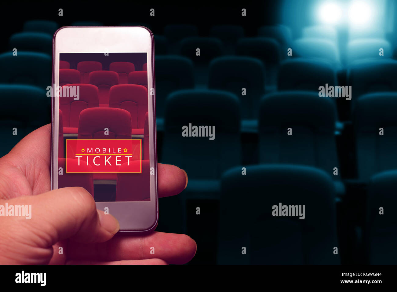 hand holding smartphone for reserved movie ticket. online ticket buying. - Stock Image