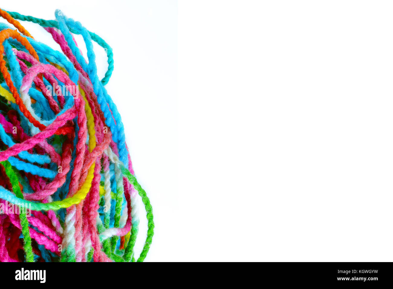 tangled yarn, tangled colorful sewing threads on white background with copy space. - Stock Image