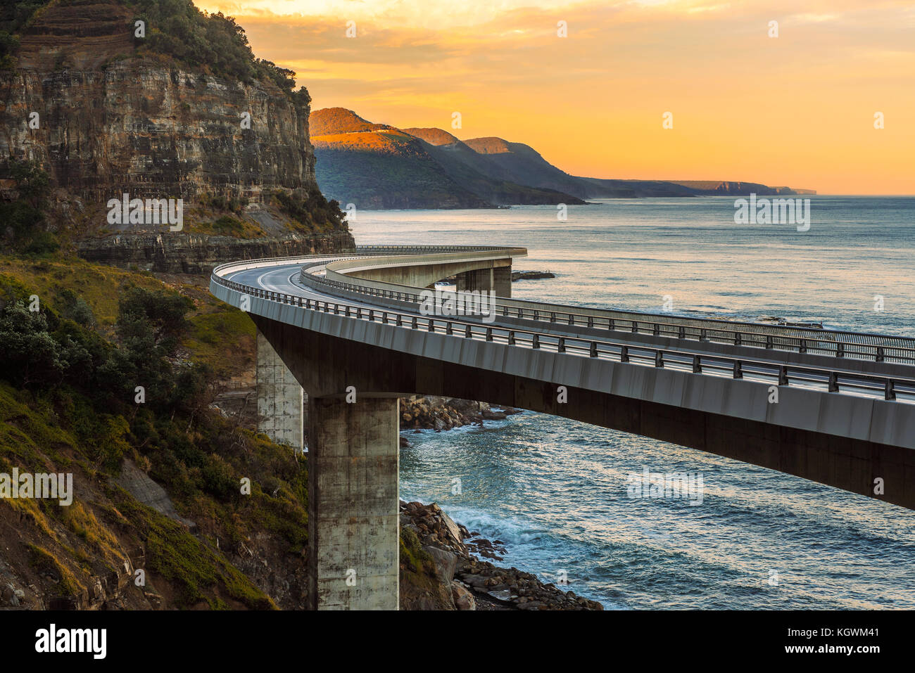 Sunset over the Sea cliff bridge along Australian Pacific ocean  - Stock Image