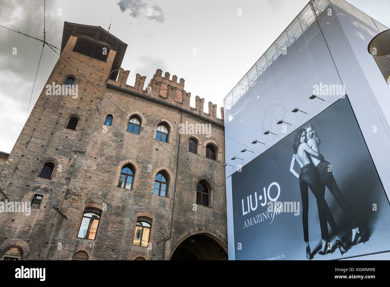 A large fashion advertising banner on the side of Palazzo Re Enzo, Bologna city life, Italy. Stock Photo