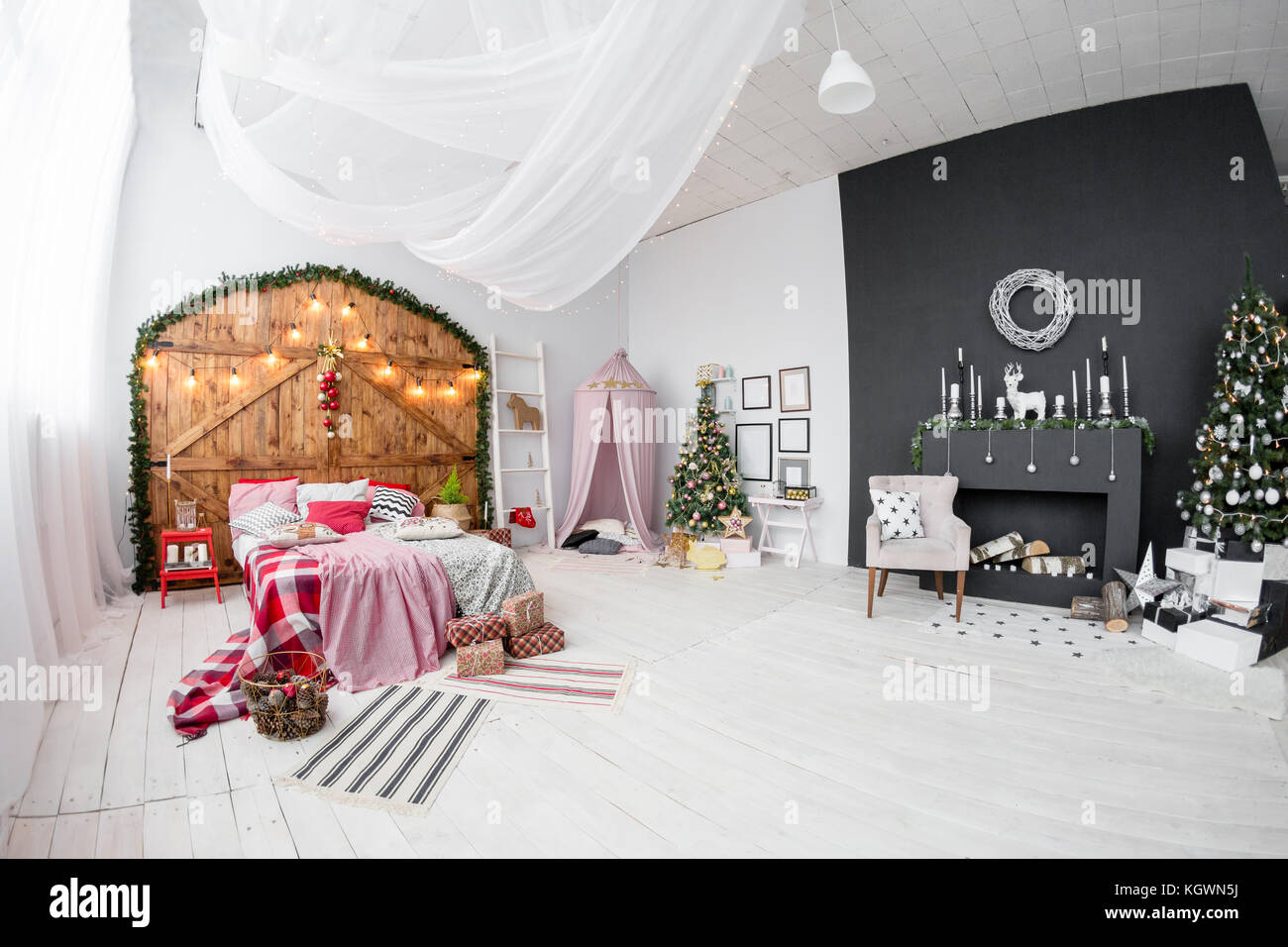 Space in the Photo studio with daylight. Christmas decorations. Stock Photo
