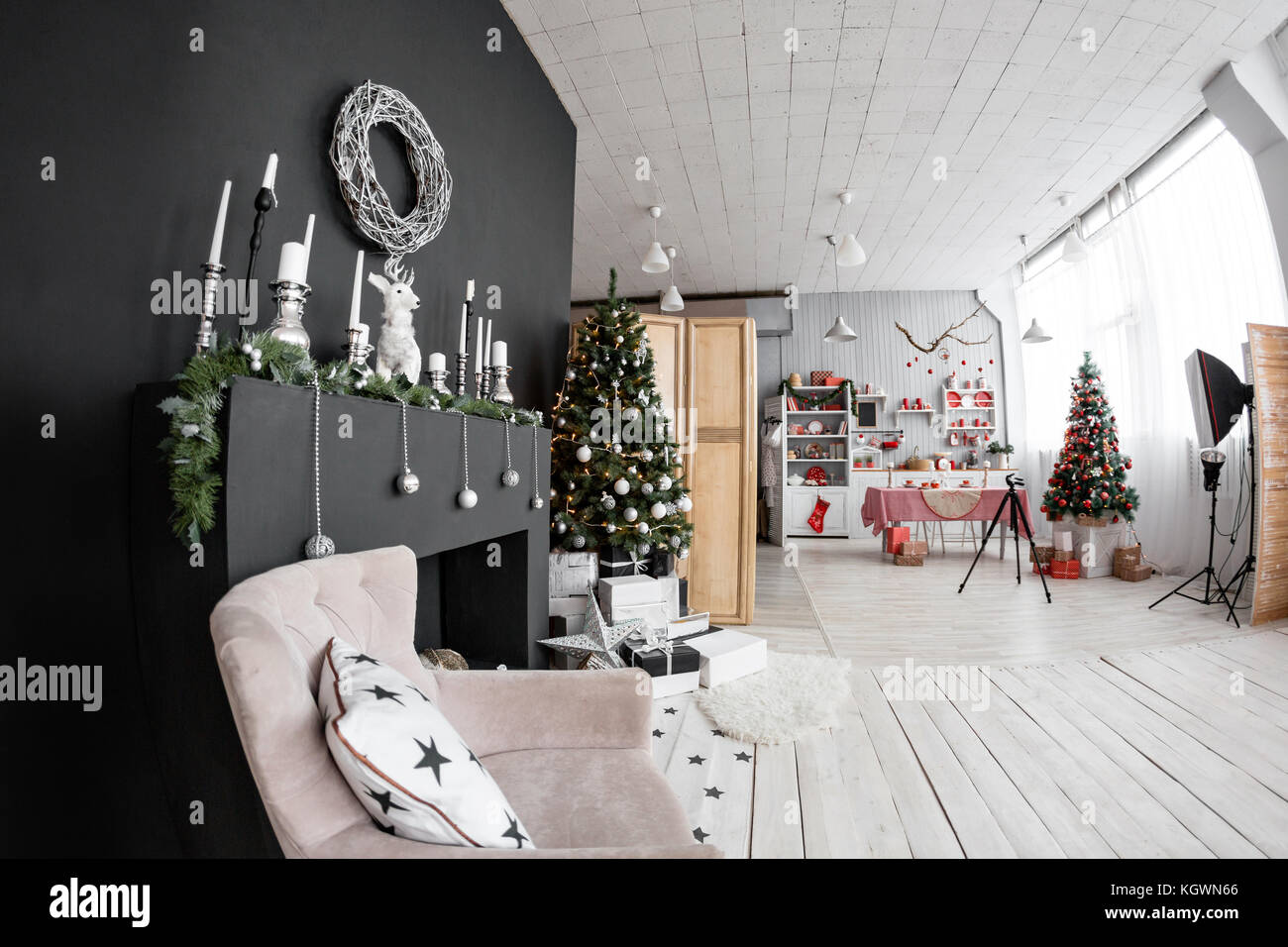 Space in the Photo studio with daylight. Christmas decorations. - Stock Image