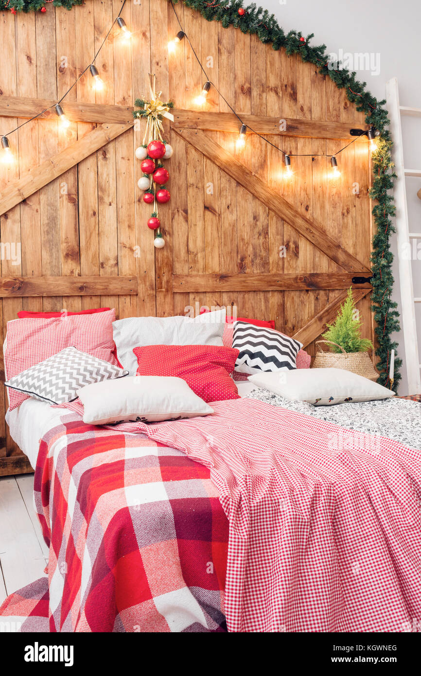 Xmas in morning bedroom. Double bed In christmas Interior on wood