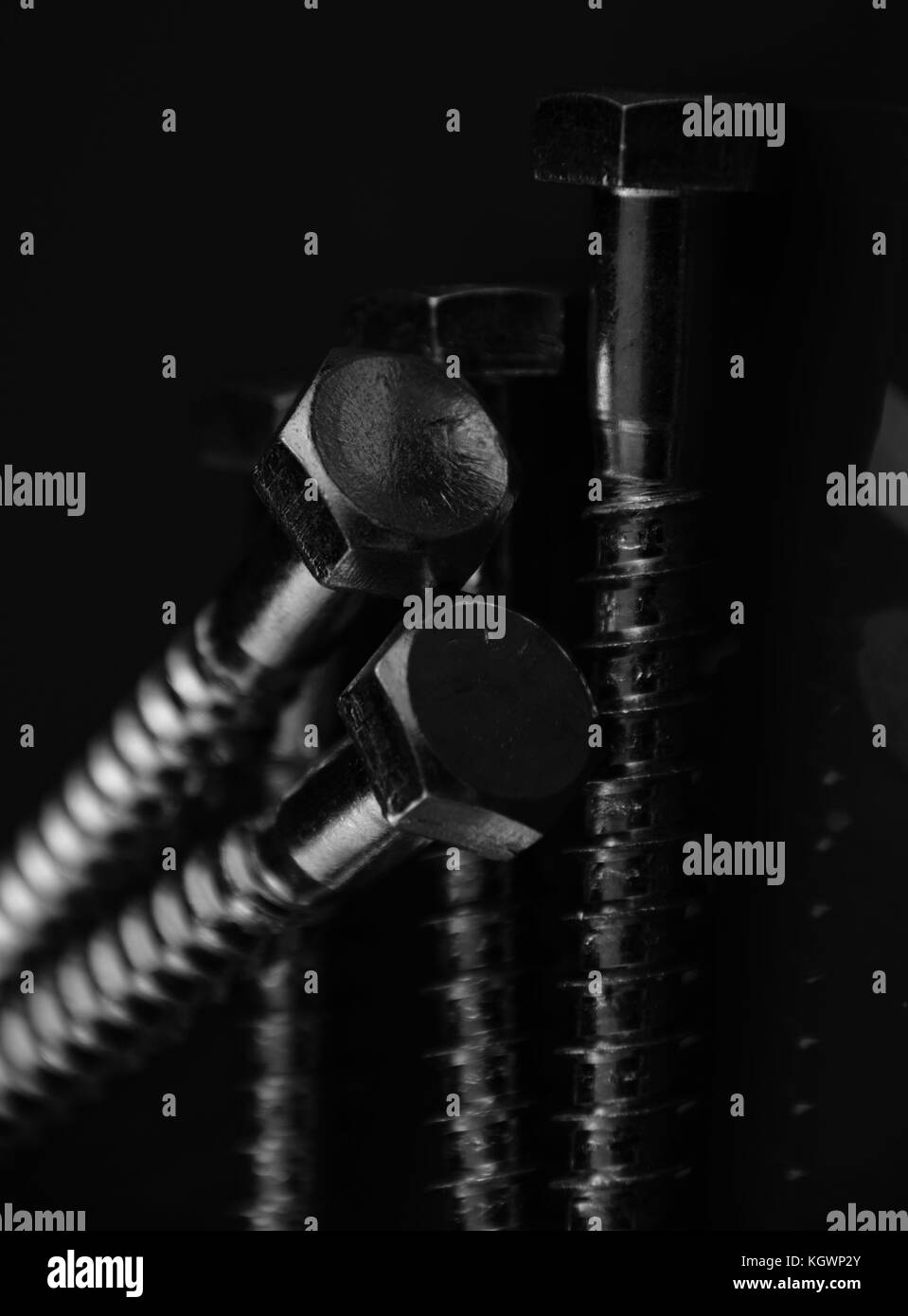 spanner or Hexagon head bolts with green Background and light reflections - Stock Image