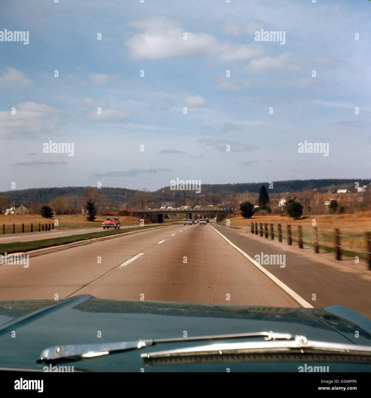 View from the front passenger seat of a car traveling southwest on the Wilbur Cross Parkway in Connecticut, May, - Stock Image