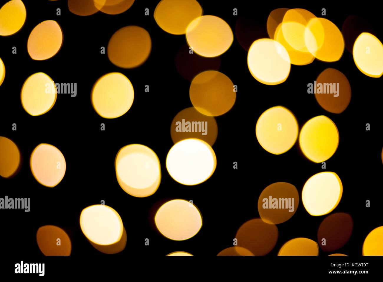 Earthy tones bokeh on black background - Stock Image