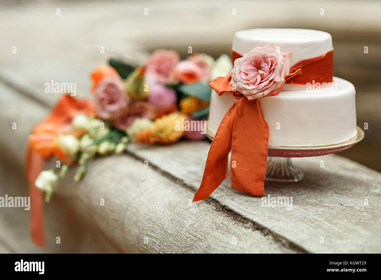white wedding cake with red flower Stock Photo