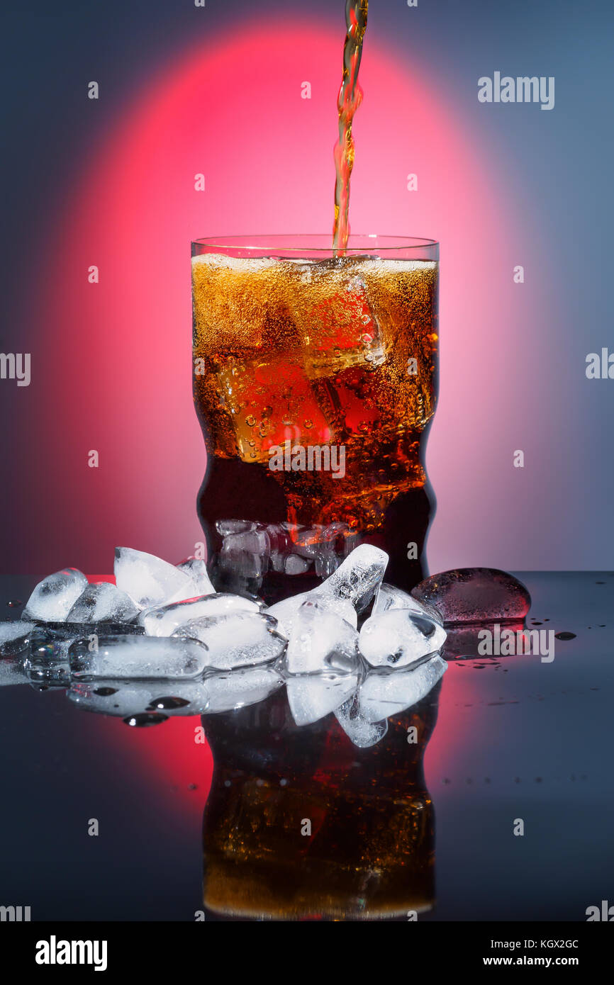 Cola in drinking glass with ice sweet sparkling carbonated drink beverage fast food with big calorie - Stock Image