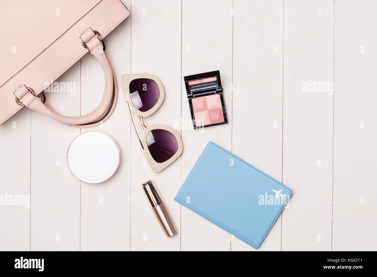 0dff3dd0245 Women cosmetics and fashion items on table with camera and passport ...