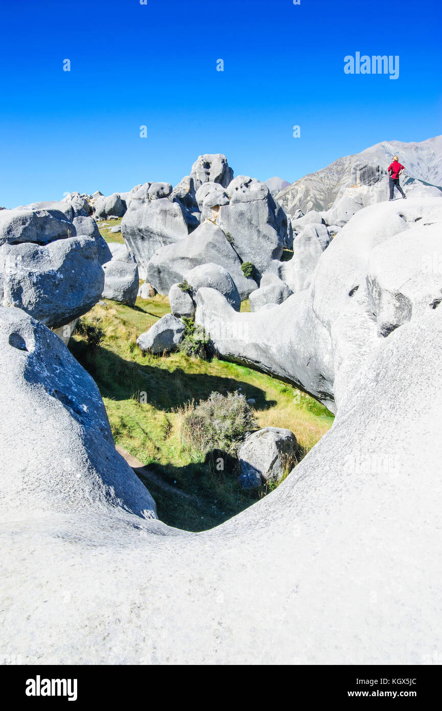 Woman standing on the Limestone outcrops of Castle Hill, South Island, New Zealand Stock Photo