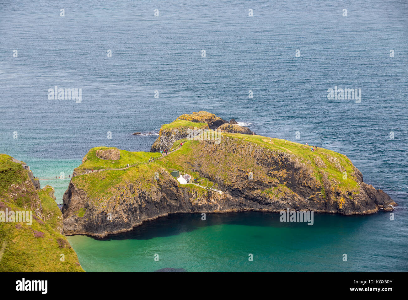 Carrick-a-Rede Rope Bridge in Northern Ireland landscape near Ballintoy. - Stock Image