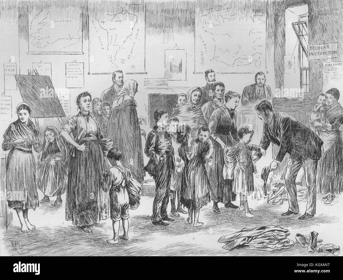 Clothing poor children in a west of Ireland schoolhouse 1891. The Illustrated London News - Stock Image
