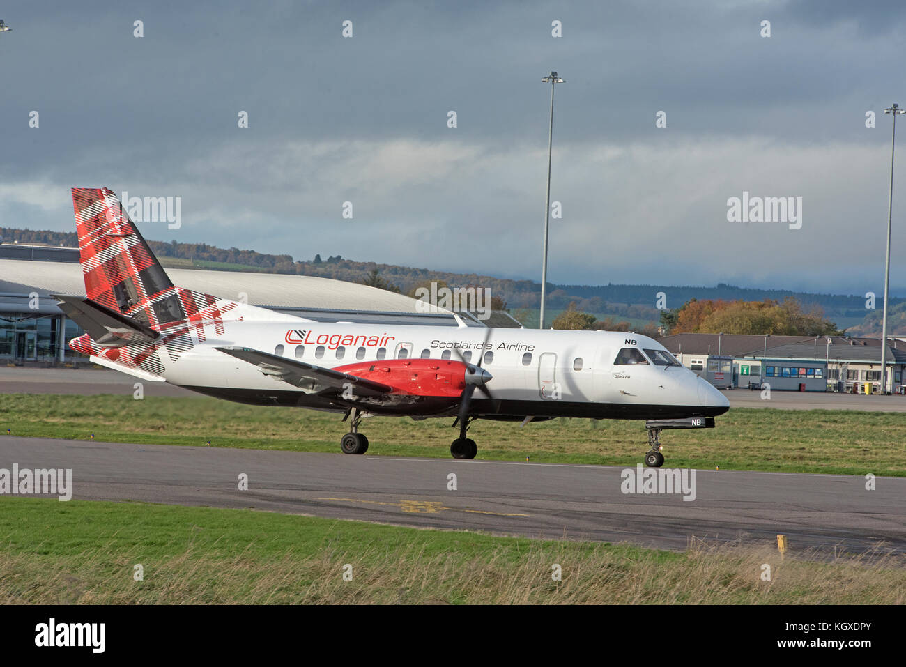 Loganair G-LGNN taxining prior to take off from Inverness Dalcross Airport. in the Scottish Highlands. Stock Photo