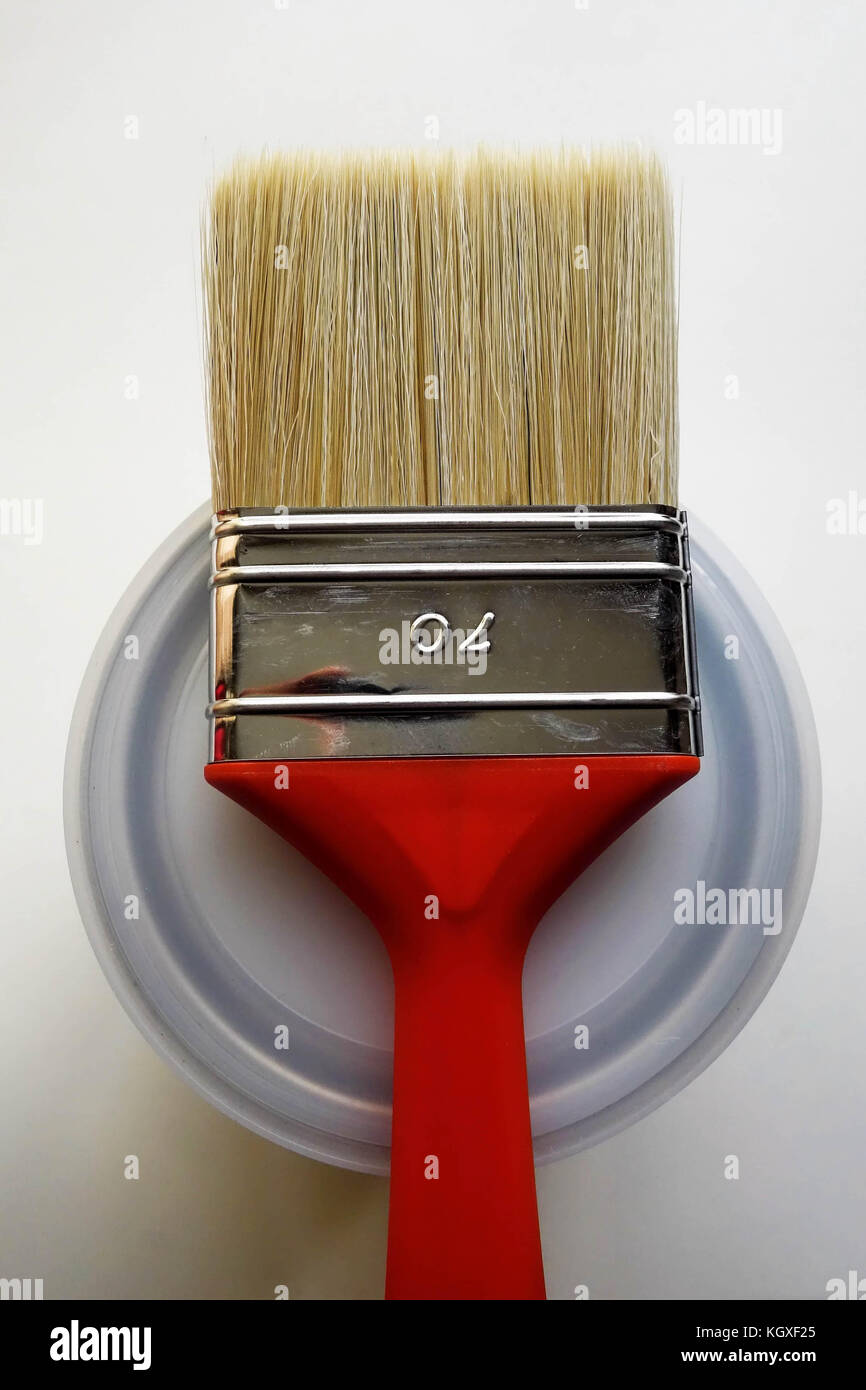 Red Paint Brush on top of Can Stock Photo
