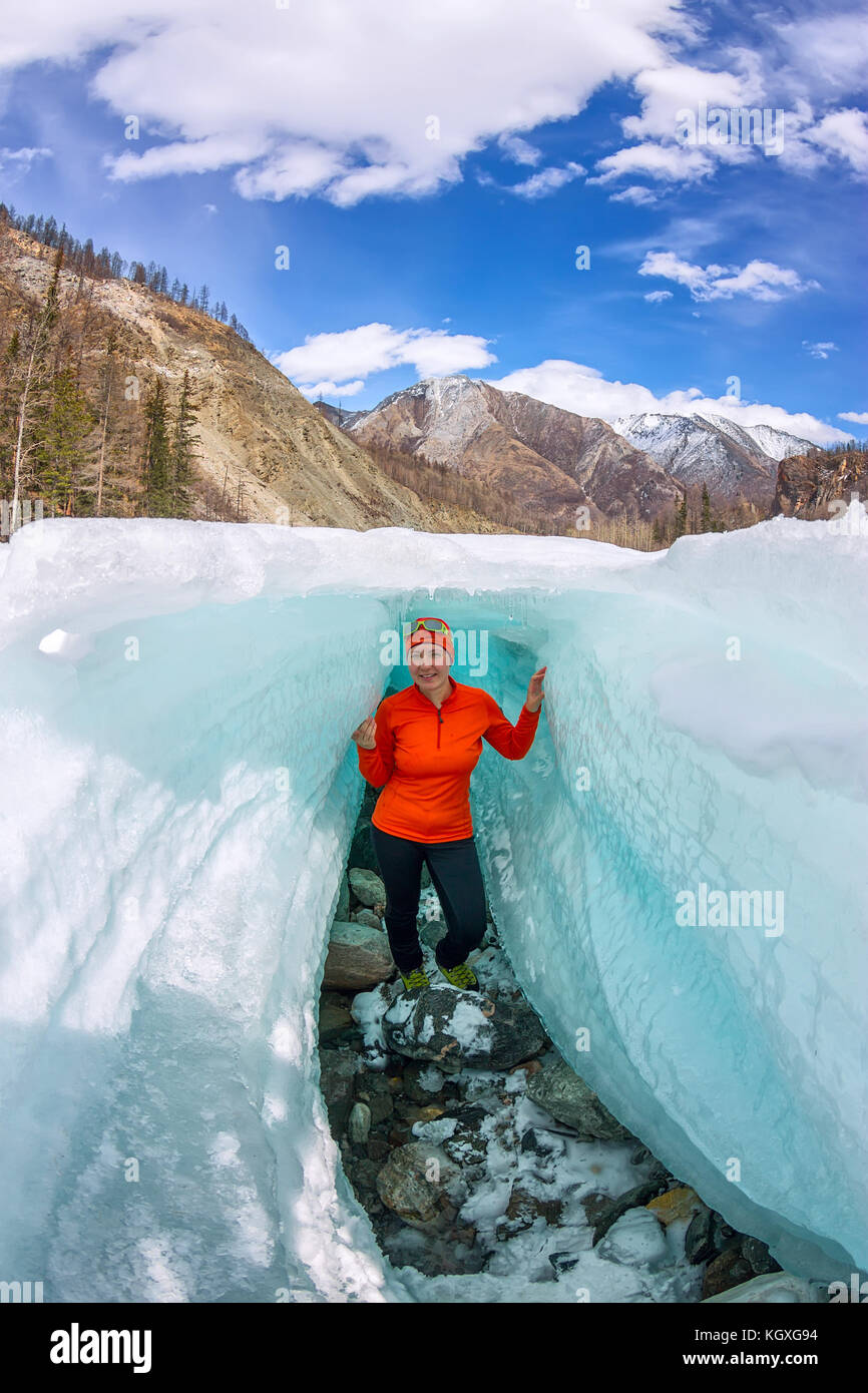 Female inside the crack in the ice glaciers Iceland. - Stock Image