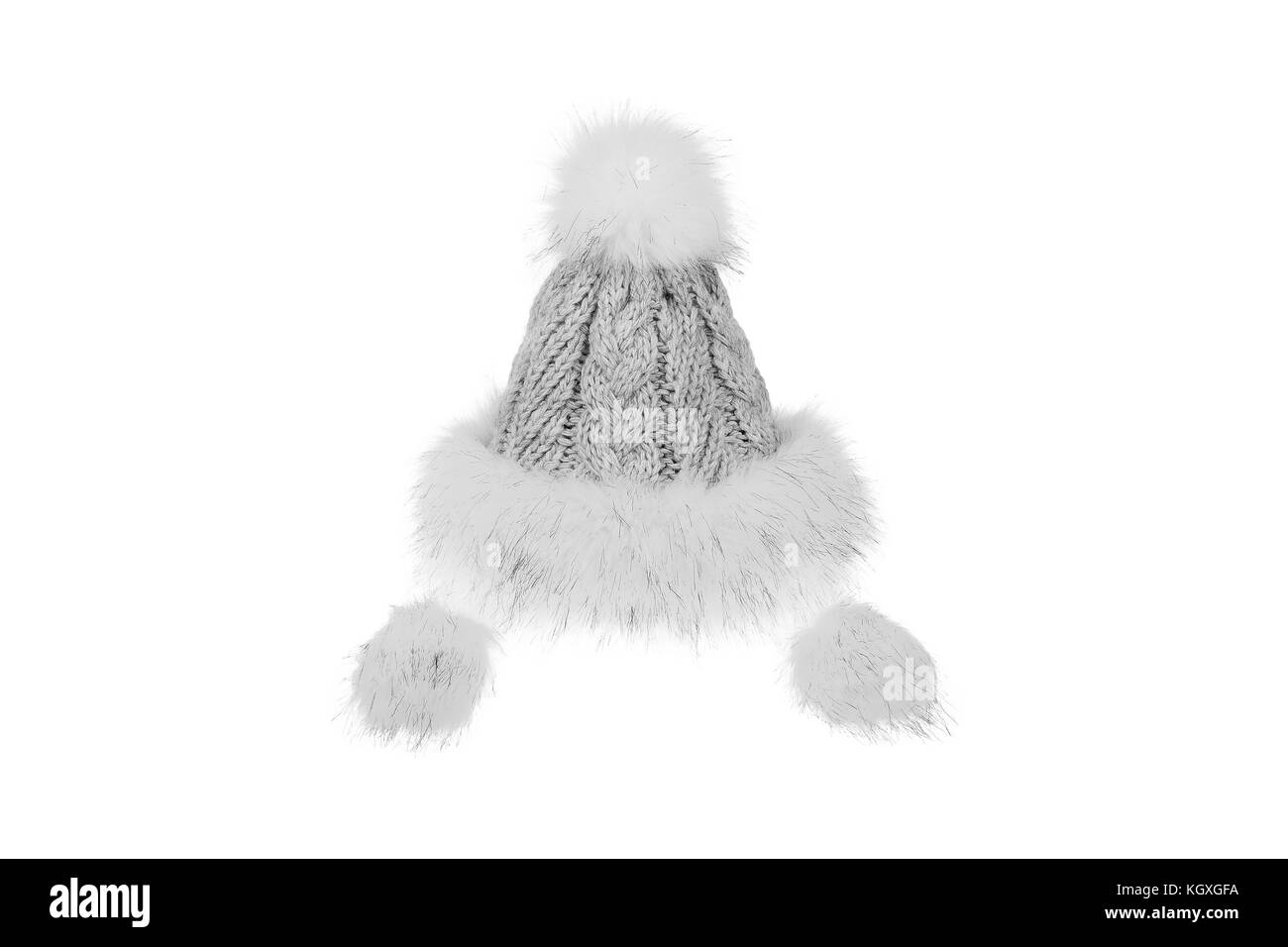 Knitted winter hat with fur isolated on white background. - Stock Image