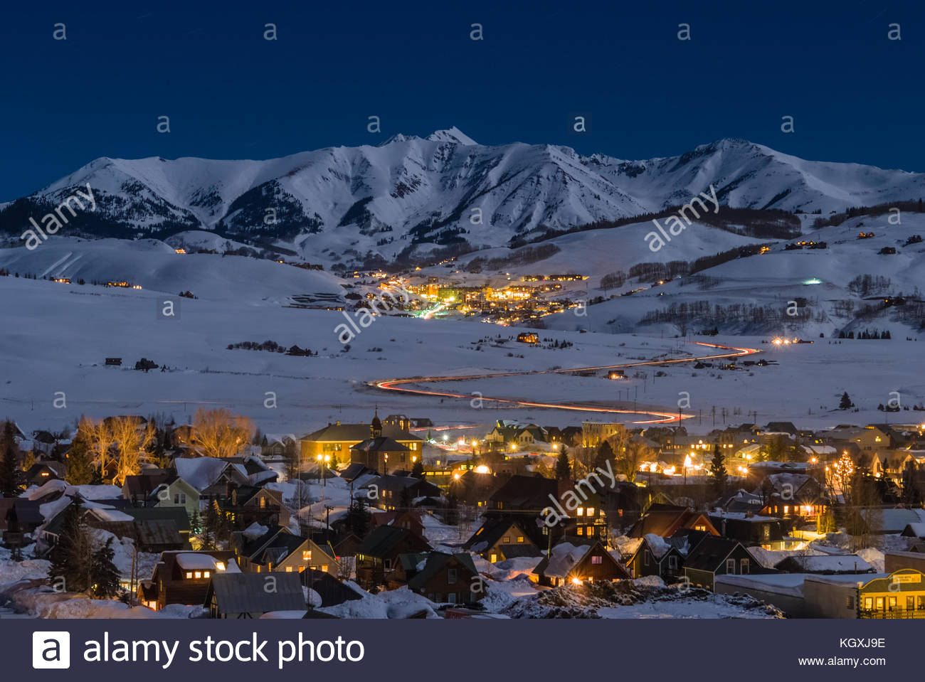 The towns of Crested Butte and Mount Crested Butte, Colorado on a cold winter night illuminated by the light of - Stock Image