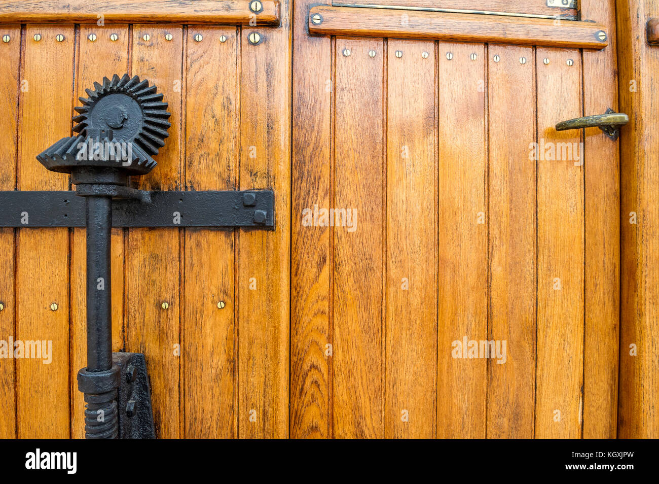 Hand operated brake gearing on a wooden railway coach. - Stock Image