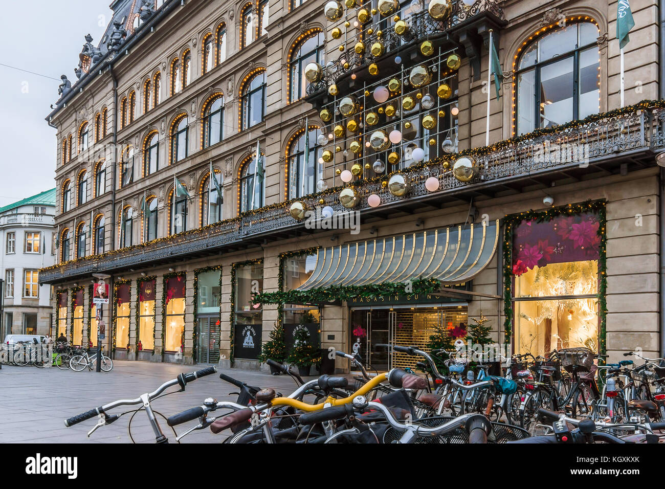 Christmas decorations and bikes at Magasin du Nord in Copenhagen, November 9, 2017 - Stock Image