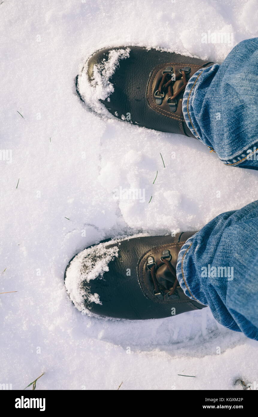 Left and Right Man's Foots in Snow from Top View - Stock Image