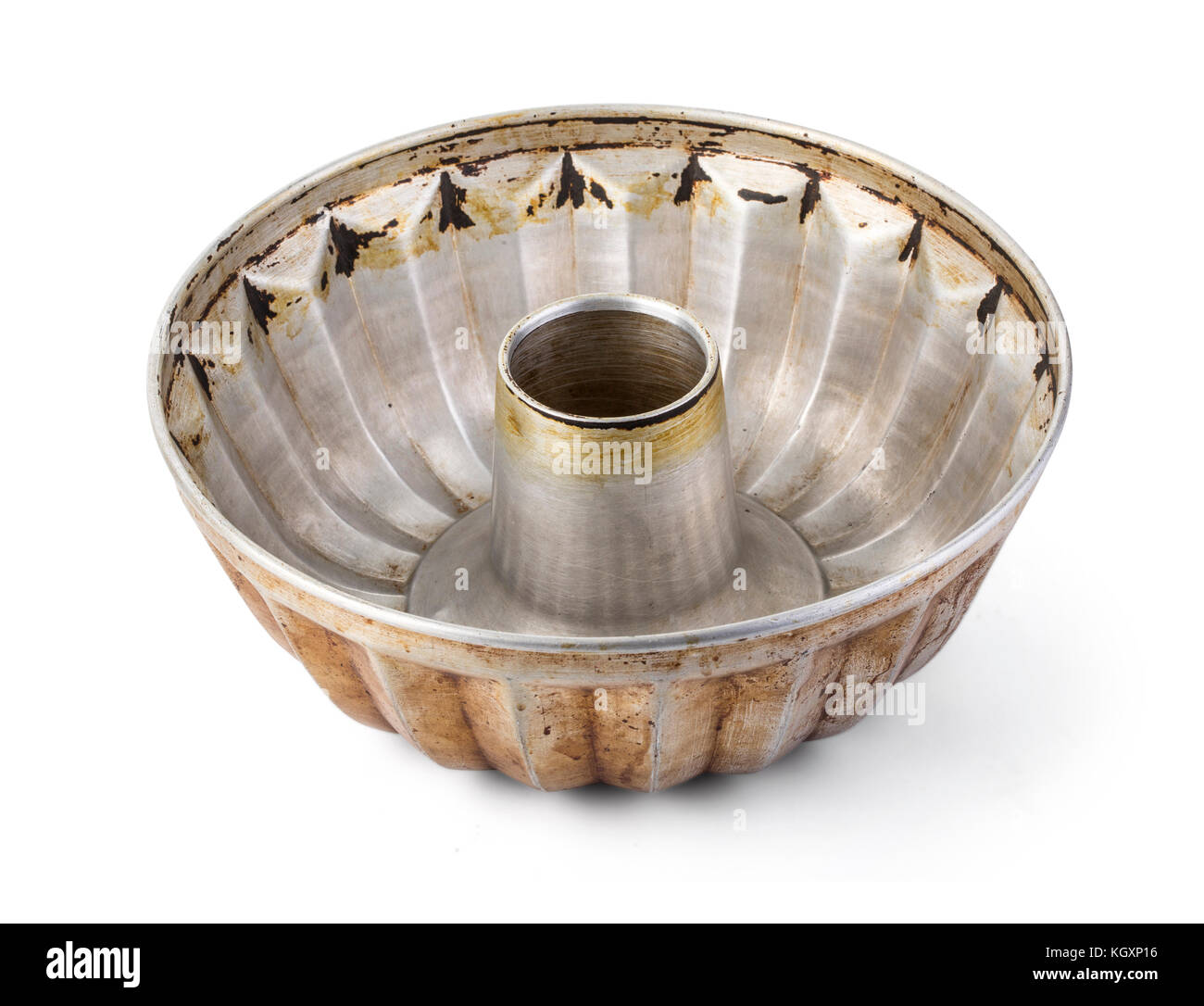 Old fluted tube baking pan isolated on white with clipping path - Stock Image
