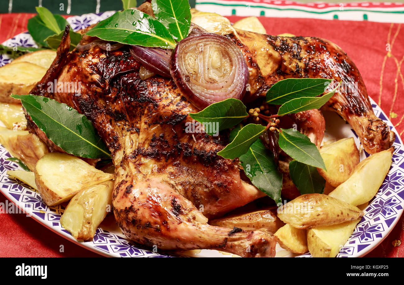A Roast chicken with roast potatoes - Stock Image