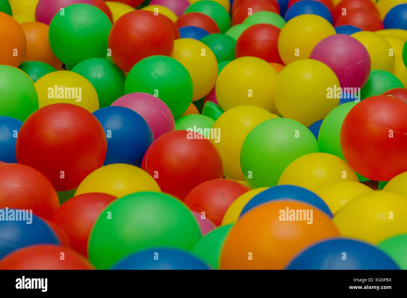 multi-colored balls on the playground horozontal - Stock Image
