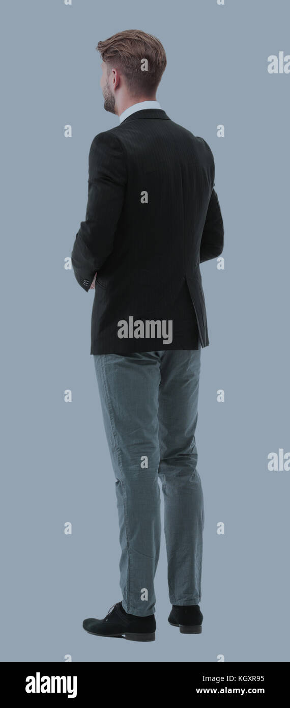 Businessman from the back - looking at something over a white ba - Stock Image