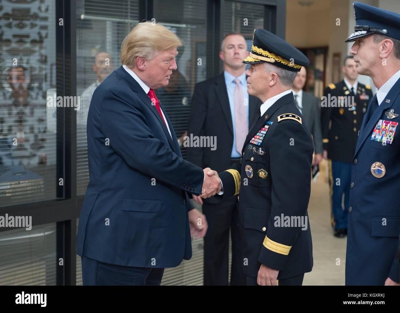 U.S. President Donald Trump (left) greets U.S. Pacific Command (USPACOM) Deputy Commander Bryan Fenton during an - Stock Image