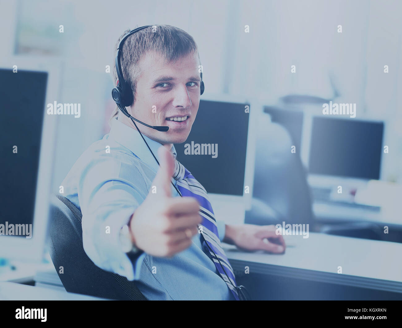 happy business man going thumbs up - Stock Image