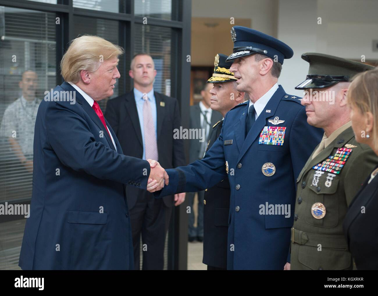 U.S. President Donald Trump (left) greets U.S. Pacific Command (USPACOM) Chief of Staff Kevin Schneider during an - Stock Image