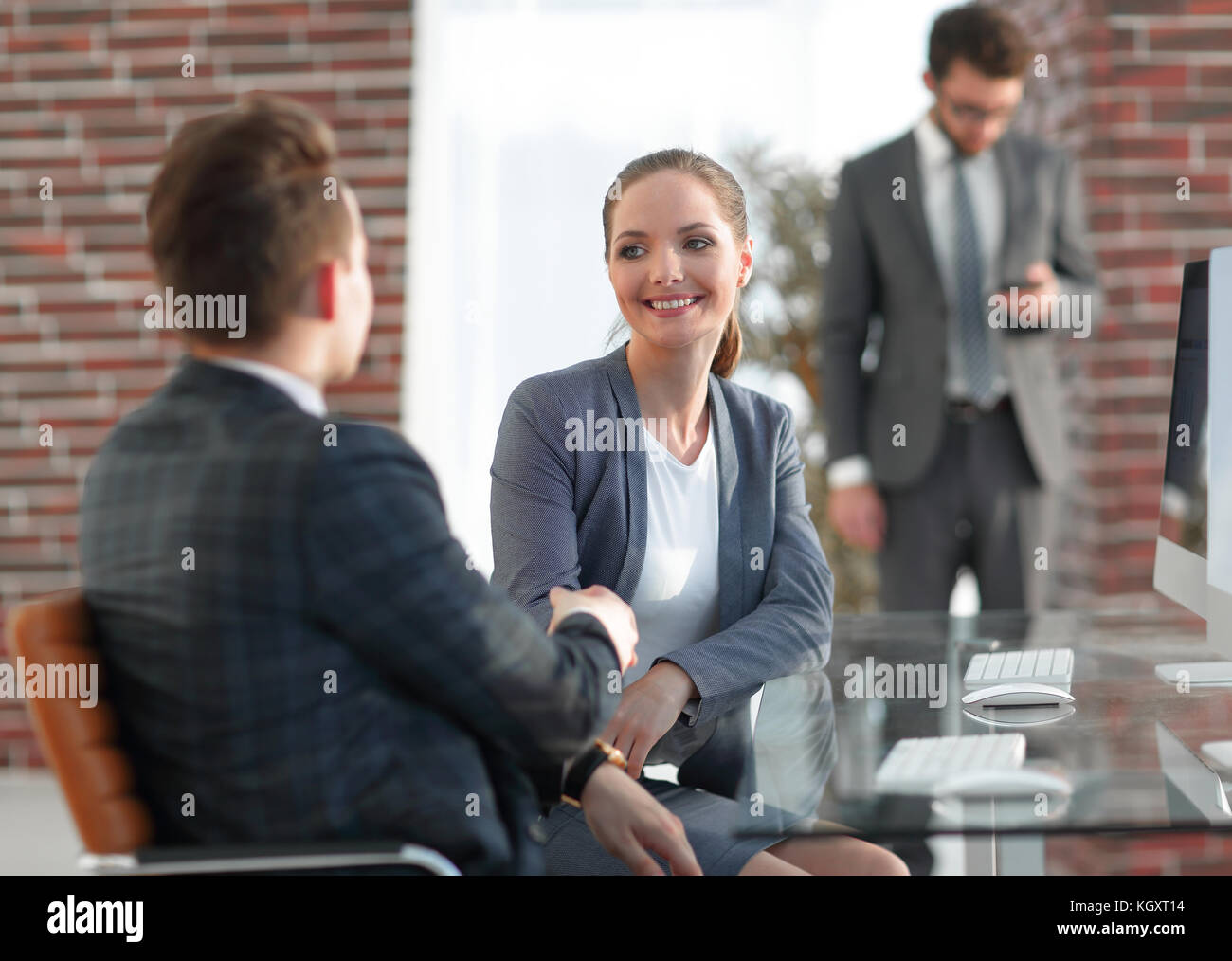 handshake Manager and the client in the office - Stock Image