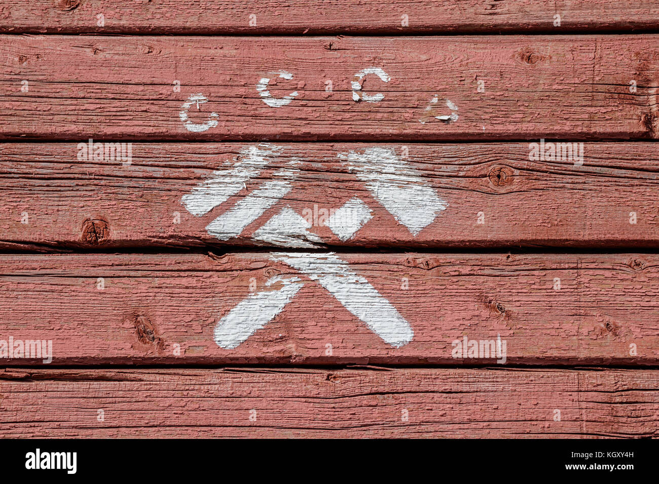 Letters CCCP (russian abbr. for USSR) and a crossed hammer and monkey wrench, a communist symbol, painted in white - Stock Image