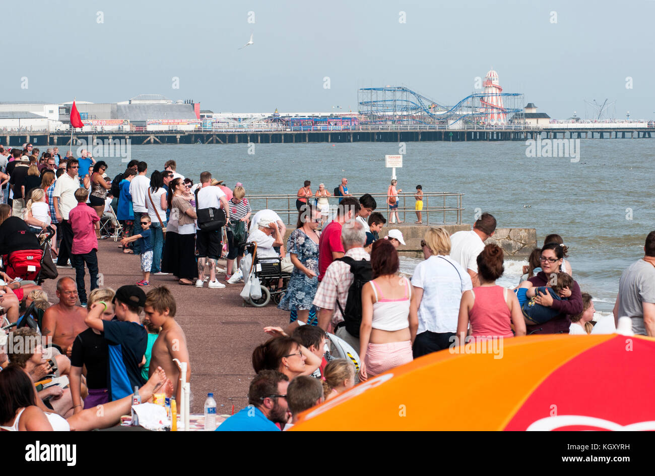 A crowded seafront in summer at Clacton-on-sea, Essex. - Stock Image