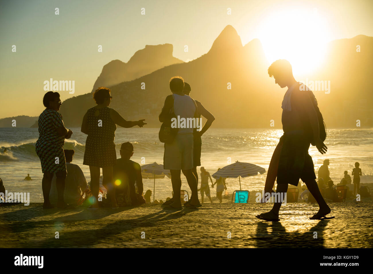 RIO DE JANEIRO - MARCH 20, 2017: People gathered watching the sunset at Arpoador, a popular summertime activity - Stock Image