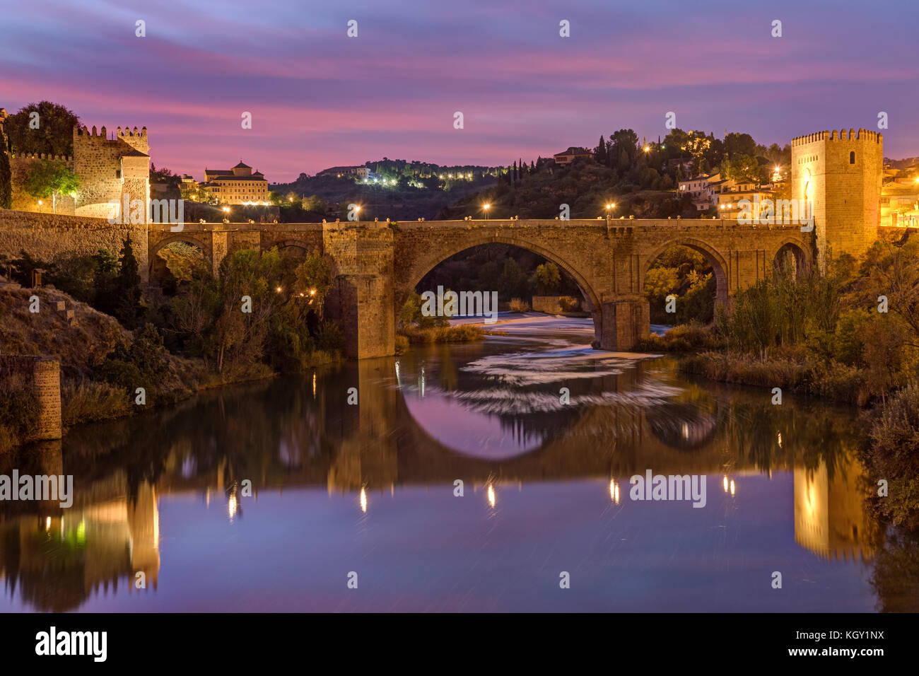 The Puente de San Martin in Toledo, Spain, before sunrise - Stock Image