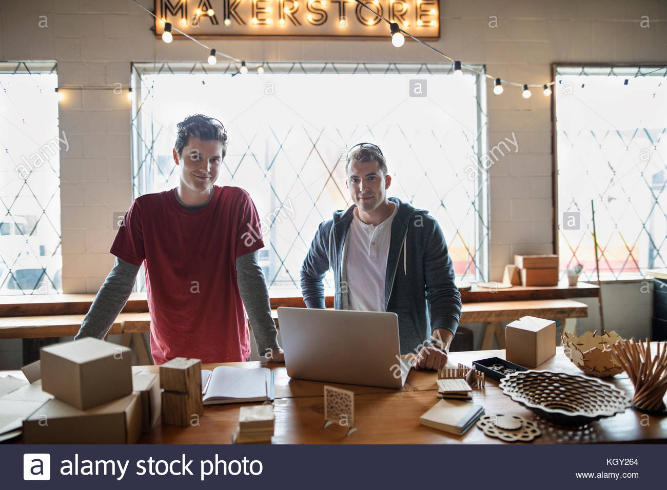 Portrait confident male entrepreneur craftsman working, packaging products in workshop - Stock Image