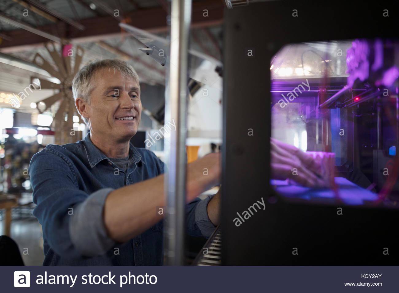 Male designer using 3D printer - Stock Image